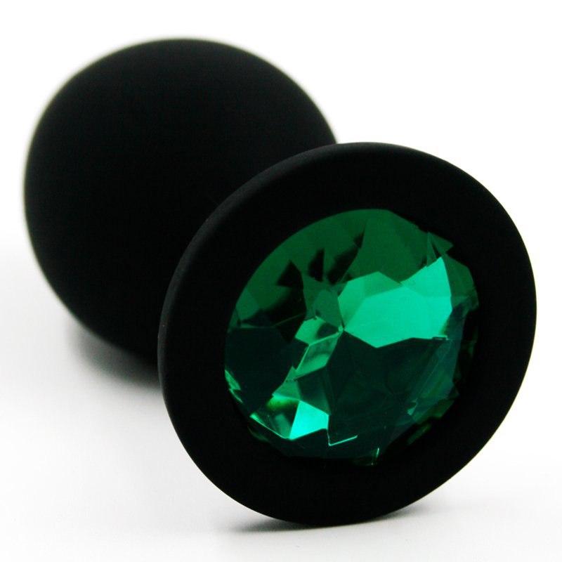 Средняя силиконовая анальная пробка Kanikule Medium с кристаллом – черный с изумрудным