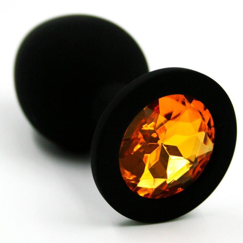Средняя силиконовая анальная пробка Kanikule Medium с кристаллом – черный с желтым